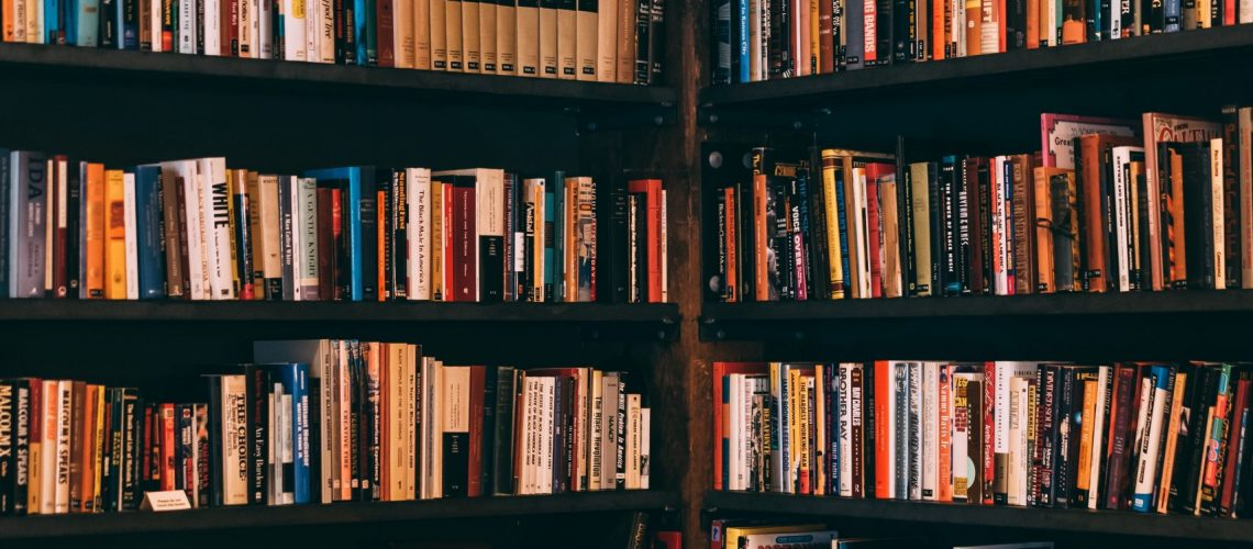 books-filed-neatly-on-shelves-1907785